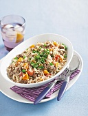 PIlaf with ground lamb, pumpkin, peas and tomatoes