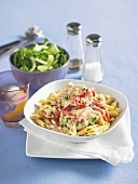 Penne with chicken breast and thinly sliced peppers in cream sauce