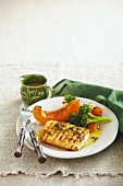 Cajun fish fillet with lemon sauce and vegetables