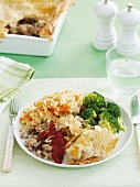 Puff pastry pie with minced meat and apples, served with potato and carrot mash