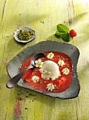 Cold strawberry soup with pistachio ice cream and pistachios