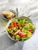 Lettuce with avocado, chicken breast and strawberries