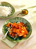 Hot-smoked salmon with rhubarb curry sauce and rice
