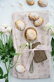 Madeleines and a spoon on a floral napkin with roses