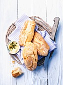 Baguette rolls and butter in a bread basket