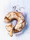 A rye bread ring on a chopping board
