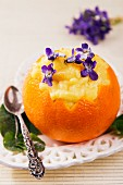 Creamy orange dessert with violets