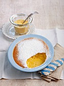 Baked pudding with orange and passion fruit, served with custard