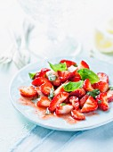 Strawberry salad with basil and lemon juice