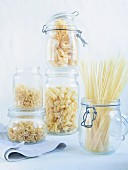 Durum wheat pasta (linguine, tagliatelle, soup pasta) in storage glasses
