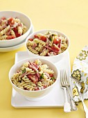 Pasta spirals with sausage and tomato