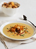 A Bowl of Apple Cheddar Soup with Bacon and Croutons