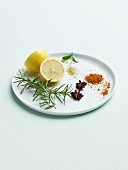 Lemon, Star Anise, Basil, Rosemary and Tandoori Spice Blend on a White Plate