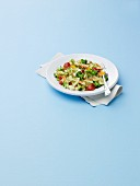 Bow Tie Pasta Salad with Broccoli and Tomatoes on a White Plate