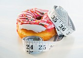 A doughnut and a measuring tape