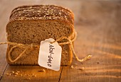 Sliced of bread, tied together, with a label (GM free)