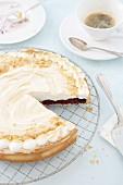 Blackberry meringue pie, one slice cut