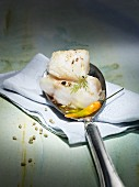 Cod fillet on a spoon