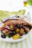 Salmon fillet on a bed of potato and radicchio salad with olives