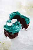 Chocolate cupcakes with petrol blue buttercream icing