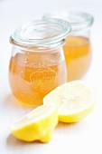 Elderflower jam in storage jars and a lemon