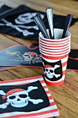 Napkins and cups for a pirate party