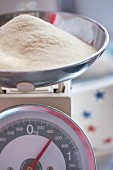 A mound of flour on a set of kitchen scales
