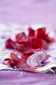 Slices of red onion and red onion peelings