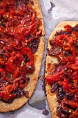 Two wholemeal pizzas with peppers and onions