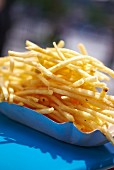 French fries in a cardboard dish