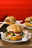 Chicken burger with mozzarella and tomatoes