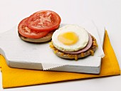 Open Ham and Egg Sandwich on an English Muffin with Tomato
