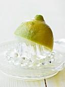 Half a lemon on a lemon squeezer