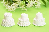Three small white wedding cakes
