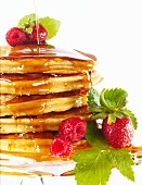 Pancakes with maple syrup, raspberries and strawberries