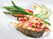 Salmon steak with avocado salsa and green asparagus
