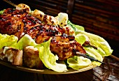 Grilled teriyaki chicken on Caesar salad