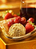 Cheese balls with walnuts and berries