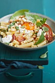 Rigatoni with herbs, cream cheese and fried egg