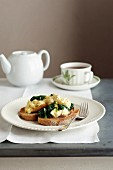 Scramble Eggs with Wilted Spinach, Pancetta, Crusty Bread, Pepper, Tea