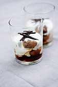 Marinated dried fruit with milk pudding served in glasses