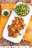 Moroccan lamb skewers with a rocket salad