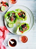 Lettuce leaves filled with chopped pork, watermelon and bean sprouts