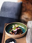 Beef cheeks with a radish salad