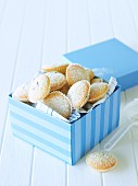 Sponge cakes with currants in a gift box