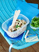 Bean salad with tuna and rocket in a plastic box