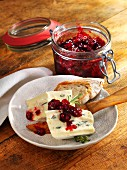 Cherries with red peppercorns and rosemary, served with cheese and bread
