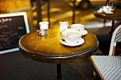 A table with coffee cups in a cafe (Paris, France)