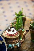 Mint tea in a tea pot and in glasses (Morocco)