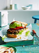 A Lebanese lamb burger with a tomatoes and cucumber salad